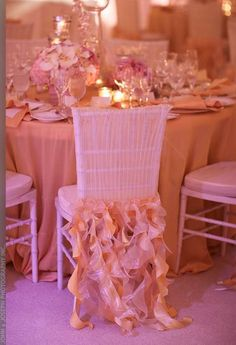 Wonderful & simple wedding chair cover with flirtatious pinkish-peach long ruffles! #coral #wedding #decoration