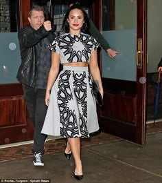 Strutting on the sidewalk:Demi Lovato stunned in a matching crop top and skirt set as she headed out of her New York City hotel on Wednesday