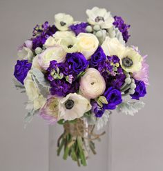gramercy garden: rich purple lisianthus and stockflower with lavender ranunculus and dahlias, vendela roses, white anemones, silver brunia and dusty miller tied with a rustic twine band.