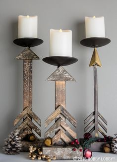 Add instant charm to your mantel by coupling warm candlelight and rustic candleholders.