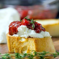 A savory and sweet strawberry chutney sits on top creamy goat cheese.  A delicious bruschetta appetizer!