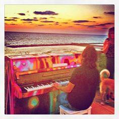 @taglitisraelexp   Piano playing at Independence Park, Hilton Beach, Israel. Sunset.