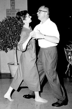 Audrey Hepburn and director Billy Wilder dancing on the set of Sabrina, 1954