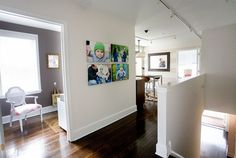 Open space looks so nice filled with portraits! {Wall Decor | Photo Display Idea} {Home Decor}