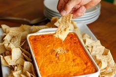 Buffalo Chicken Dip -- this buffalo chicken dip is a deliciously close copy of our favorite appetizer served at a local bar and grill, perfect for tailgating! | via @unsophisticook on unsophisticook.com