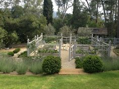LOVELY II  gated garden enclosure containing RAISED BEDS , all with IRRIGATION | aka #potager or kitchen garden • gravel path • lavender • English thyme• roses• espaliered fruit trees • beautifully stained fence •  design: Brooke & Steve Giannetti. Original pin description courtesy: https://www.pinterest.com/rustysurfer/edible-garden/  :)