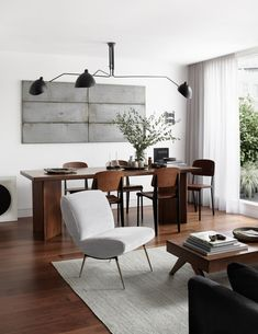 """Everything has a clear purpose,"" says Ferrer of the pared-back and function-driven London apartment he designed for a client. The custom dining and coffee tables were designed by Ferrer. The lighting fixture is a Serge Mouille reproduction. Decor, Room, Interior, Nordic Design, London Apartment, Home Decor, Interior Design, Walnut Furniture, Architectural Digest"