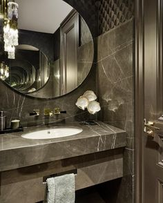We love a bit of drama in a guest WC, created here with marble slabs laid over…