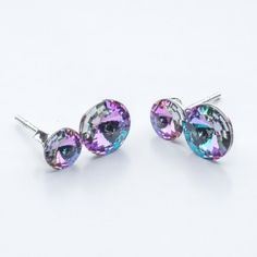 Swarovski Rivoli Earrings 6/8mm Vitrail Light  Dimensions: length:1,5cm stone size: 6mm and 8mm Weight ~ 1,60g ( 1 pair ) Metal : sterling silver ( AG-925) Stones: Swarovski Elements 1122 SS29 ( 6mm ) and SS39 ( 8mm )  Colour: Vitrail Light 1 package = 1 pair
