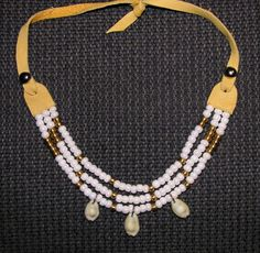Cowrie Necklace I made with leather, white glass beads, solid brass beads, and cowrie shells. $55 (tax & shipping to anywhere in Canada/USA included) Buy Now:  https://www.paypal.com/cgi-bin/webscr?cmd=_s-xclick&hosted_button_id=MDHBVFSXNN3AC