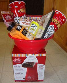 "Movie Night Basket Gift Movie Basket with ""Marley & Me"" movie, popcorn machine, popcorn bowl, popcorn an. Popcorn Gift, Popcorn Toppings, Movie Popcorn, Popcorn Bowl, Diy Gift Baskets, Raffle Baskets, Basket Gift, Marley And Me Movie, Stag And Doe Games"