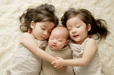 Adorable Twin Sisters and Newborn by Eden Bao