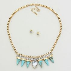 Dinosaur- vegetarian or carnivore?  Dinosaur necklace set has spikes made of turquoise stones set in a thick gold chain. Clear and topaz colored rhinestones finish the necklace off with a funky edge.  Necklace is 18 inches long. Clear rhinestone earring studs have a standard post. #SweetSangria #jewelry #trending #eyecandy #unique #boho #accessories #fashion #coolmom #womensjewelry