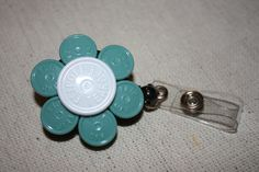 Upcycled/Recycled Retractable Flower ID Badge Holder With Retractable Reel-Made From Flip Off Caps From Medication Vials-Rn, Medical, Nurse. $5.00, via Etsy.