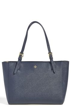 Tory Burch Small York Saffiano Leather Buckle Tote - Goldtone logo hardware perfectly complements scratch-resistant, glazed leather handbag topped with slender, belted handles. Dual interior compartments with center zip-pocket divider , structured silhouette means it holds its shape, adjustable straps, interior zip, wall and cell-phone pockets; key clip. Perfect for professionals going on job interviews.