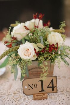 White roses, seeded eucalyptus, wine cork, vintage-style tag, table numbers, winery wedding // April Bennett Photography
