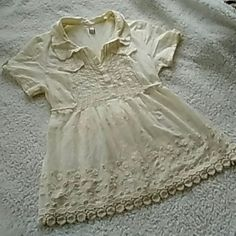 Free People Top Sz M Free People Top Sz M...absolutely adorable cream top with amazing detailing...slightly sheer...v-neck with tie in back...looks amazing on...worn couple times...in excellent condition Free People Tops Blouses