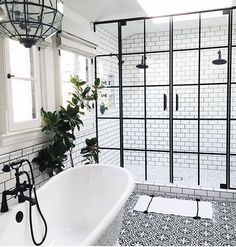 Just Pinned to Salle de bain: Bathroom with black hardware, black framed shower doors, black and white patterned encaustic tile floor, designed by Life Style LA, via Bathroom Renos, Bathroom Interior, Home Interior, Bathroom Ideas, Bathroom Remodeling, Shower Bathroom, Interior Modern, Bathroom Furniture, Bathroom Goals