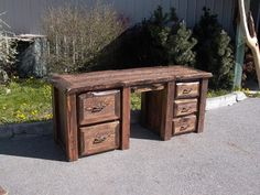 Here is the BIG one, Beautiful Red Fir with the live edge around the top and drawer fronts. Features a keyboard tray and 2 file drawers. In stock and ready for pick up, or we can help you design your own desk.