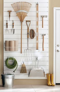 Yard work is a breeze when your garage is organized! Get this wall unit from #MarthaStewartLiving and more ideas to store your homekeeping essentials.