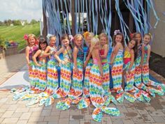 DIY Mermaid Tail Wrap Arounds - Fun in the water is a plus for these kinds of parties. If you want to poke a little more fun to your Summer themed party then, how about adding mermaid wrap around towels to the mix? There are plenty of do it yourself tutorials on how to make them and I am sure it will be a hit for children's parties. After all, even adult women want to dress up like mermaids too.