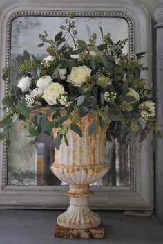oses & Eucalyptus in cream iron urn - an exquisite and unexpected pairing that makes for a sophisticated look!