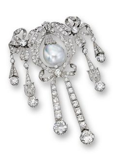 c1905 Natural Pearl and Diamond Brooch The stylised ribbon brooch centring on a semi-baroque natural pearl measuring approx 14.31 x 14.18 mm, decorated throughout w old European-cut diamonds, the diamonds together weighing approx 11.50 carats, mounted in platinum