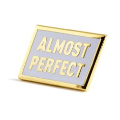 "*NOTE* Pin is actually perfect - Gold pin with white enamel - Rubber backing - Measures .875"" wide"