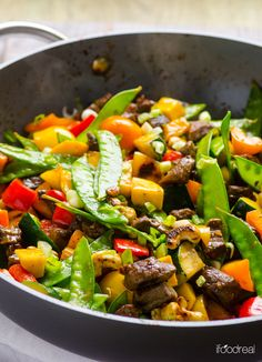 Healthy Beef and Cashew Stir Fry with bell peppers, zucchini and snow peas.