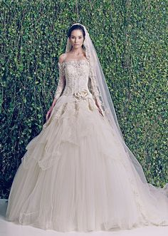 Zuhair Murad wedding dresses; bridal collection F/W 2014-2015; we love the victorian inspiration in this wedding gown with sleeves, lace, corset and tulle