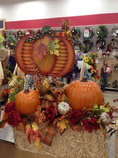 Fall hay bale tabletop arrangement with pumpkins. Laura A. Tulsa Michaels (3864)