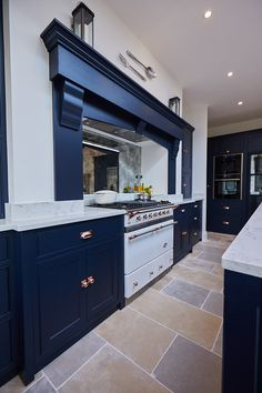 White Macon range cooker by lacanche with dark blue mantle on false chimney breast - The Main Company Kitchen Mantle, Kitchen Chimney, Home Decor Kitchen, Condo Kitchen, Open Plan Kitchen Dining Living, Navy Kitchen, Country Kitchen, Dark Blue Kitchens, Cool Kitchens