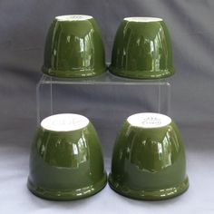 4 Vintage Hall Pottery Custard Cups. This is a group of 4 dark green Hall China Restaurant Ware pottery custard cups.   *****SOLD*****