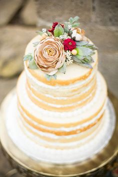 gorgeous wedding cake - love the colours of the flowers on top, and the delicate layers look delicious
