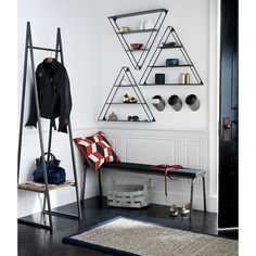 Shop butler stand.   No coat closet? No worry.  Our minimalist butler is on duty in a minimum of space.  Handcrafted iron frame architects a sleek spot to hang coats with a mango wood shelf below to leverage shoes and bags.