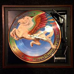 A Steve Miller Band picture vinyl wall clock on a retro General Electric turntable.  recycle repurpose