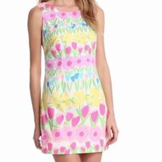 NWT Lilly Pulitzer Fluorescent Delia Dress NWT Lilly Pulitzer Fluorescent Delia Dress in multi floral line dance. Shift styling with white side bows, yellow exposed back zipper with pink grosgrain trim and scoop back. Adorable bright dress. Lilly Pulitzer Dresses Mini
