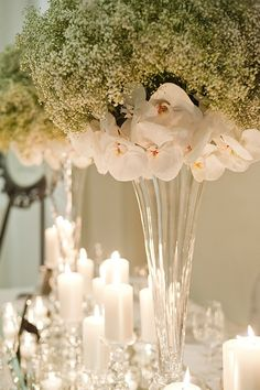 Baby Breath and Orchid Centrepiece...I would do hydrangeas instead of orchids but I love the baby's breath