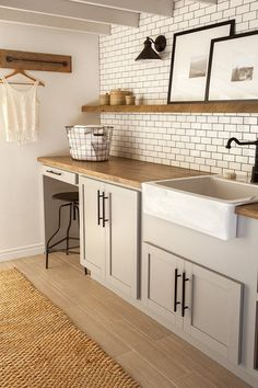 condo laundry room: things to copy: wood-look tile floor, wooden counter top, dark grey grout in between subway tile