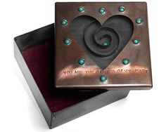 Ooh.  I really like this!  Copper & Glass Heart box, $145.