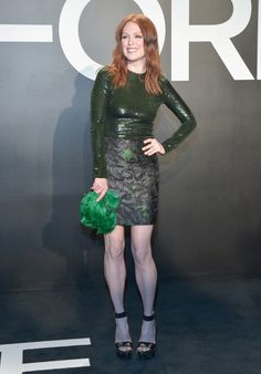 Julianne Moore in deep green sequin long-sleeve, printed skirt, green feathered bag, and studded platforms at Tom Ford F/W '15 in Los Angeles