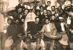 Pancho Villa and Emiliano Zapata at the Presidential Palace in Mexico City, December 6, 1914