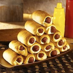 Pigs in a blanket Twist - Brown Sugar & honey glaze! Always gone in 2 seconds when I make them! Always a hit!