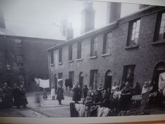 Back to Back Houses in Birmingham. A photograph of a picture displayed at the Back to back houses museum in Birmingham