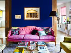 Yves Klein Blue wall with pink sofa in Annie Schlechter's apartment.
