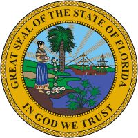 "Florida state seal adopted by 1865 legislature, which mandated that the seal be the size of the American silver dollar and display a scene in the center ""of the sun's rays over a high land in the distance, a cocoa tree, a steamboat on water, and an Indian female scattering flowers in the foreground, encircled by the words, ""Great Seal of the State of Florida: In God We Trust.'"" In 1970 the seal was updated. cocoa tree replaced by palmetto palm, headdress removed from woman & changed to…"