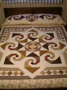 Star Reel, designed by Judy Martin for her book, Scrap Quilts. Used here as the central medallion of a queen size quilt. Hand quilted by Marlene's Quilts, $425.00 on Etsy.