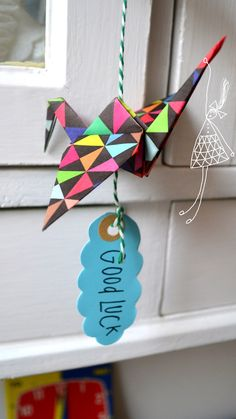Inspiration: origami paper crane gift to wish good luck (Japan) and/or wisdom (China). See paper crane video tutorial on this board.