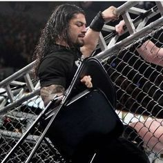 The WWE champ can do amazing things with a steel chair. Roman Reigns Wwe Champion, Wwe Superstar Roman Reigns, Wwe Roman Reigns, Roman Empire Wwe, Roman Regins, The Shield Wwe, The Joe, Fitness Workout For Women, Wwe Wrestlers