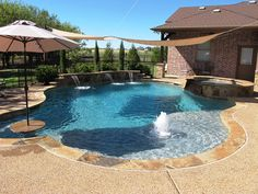Picture 12: Free-form pool with bubbler fountain and flagstone table